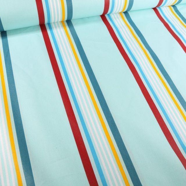 Tissu Coton enduit Playa jaune sur fond Bleu - Par 10 cm
