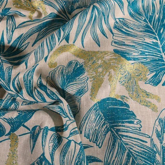 Tissu Lin d'ameublement Feuilles bleu pétrole et singes dorés sur fond Naturel - Par 10 cm