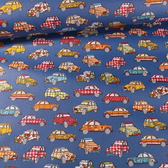 Tissu Coton enduit Dedeuche sur fond Bleu - Par 10 cm