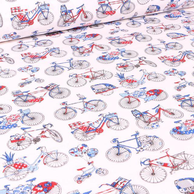 Tissu Coton imprimé Arty Bicyclette rouge et bleu sur fond Blanc