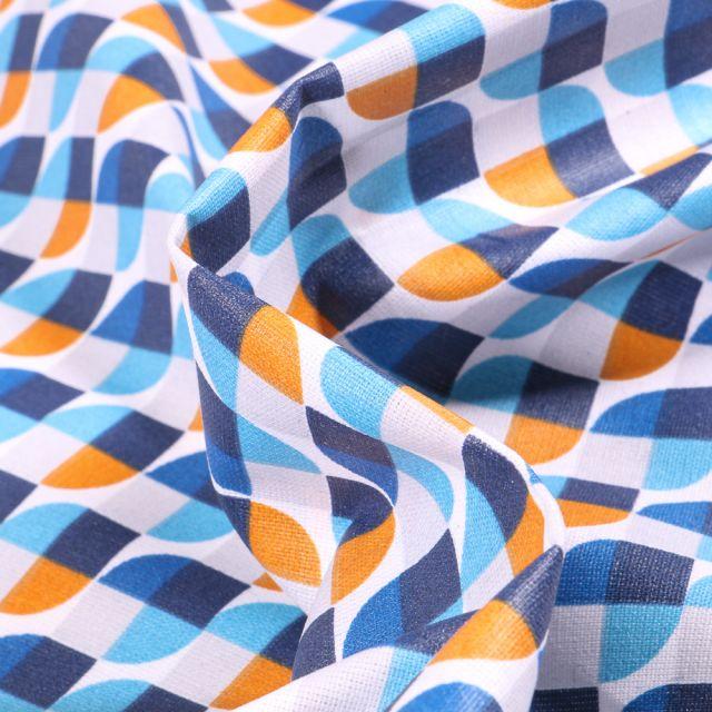 Tissu Coton enduit Seventies bleu sur fond Blanc