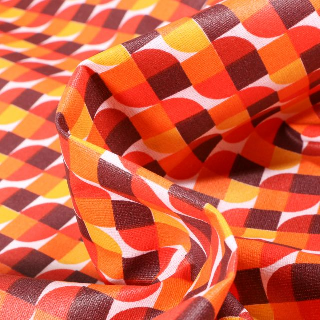 Tissu Coton enduit Seventies orange sur fond Blanc