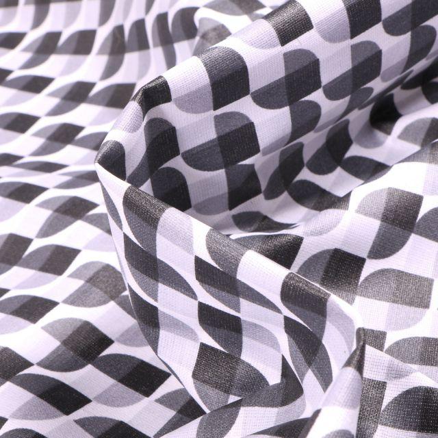 Tissu Coton enduit Seventies gris et noir sur fond Blanc