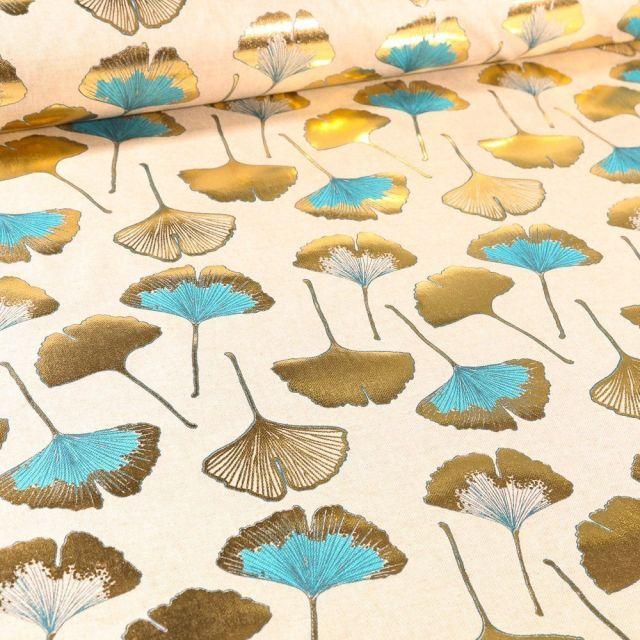 Tissu Toile Coton Feuilles Gingko dorés et bleues sur fond Naturel - Par 10 cm