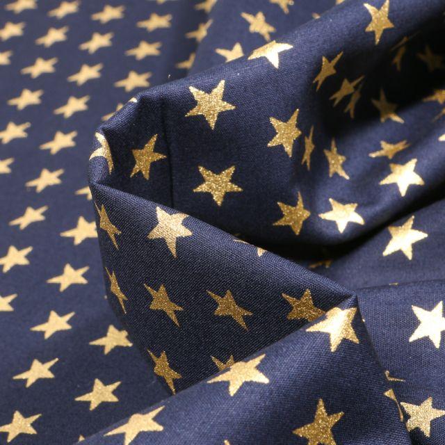 Tissu Coton imprimé Etoiles dorées 1 cm sur fond Bleu marine