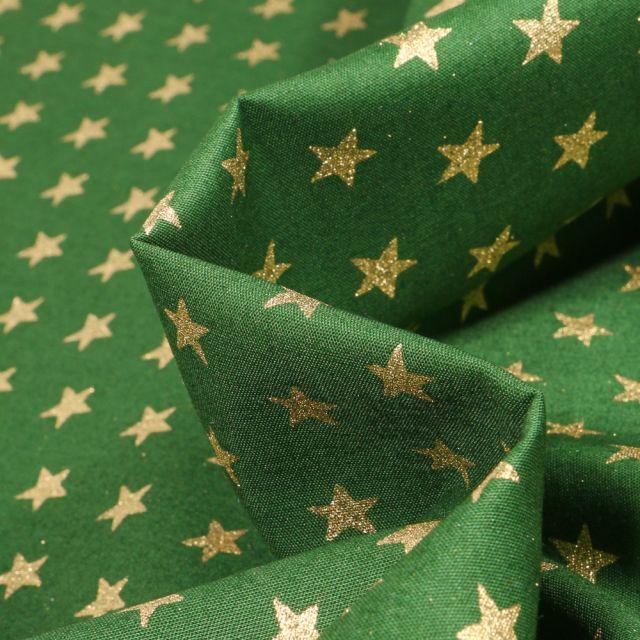 Tissu Coton imprimé Etoiles sur fond Vert sapin - Par 10 cm