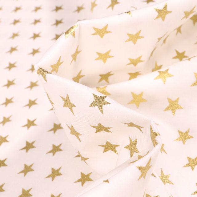 Tissu Coton imprimé Etoiles dorées sur fond Ecru - Par 10 cm
