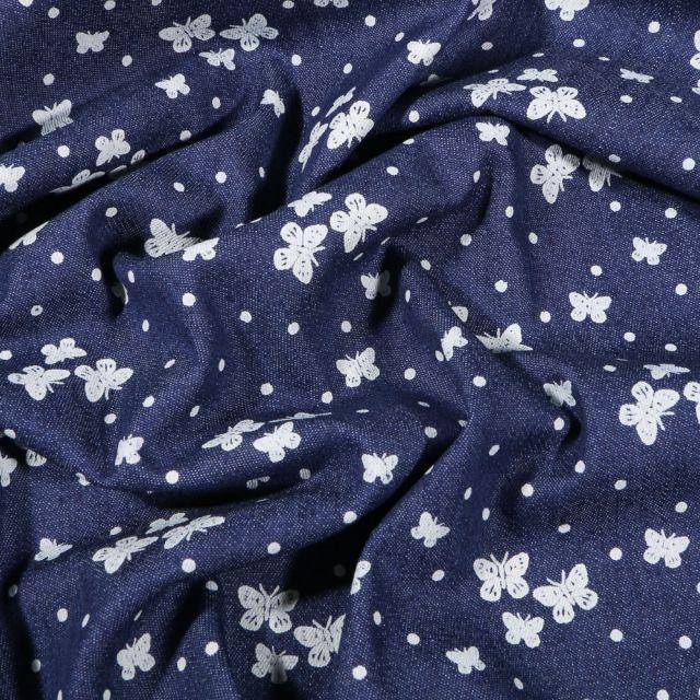 Tissu Jean élasthanne  Butterfly sur fond Bleu foncé - Par 10 cm