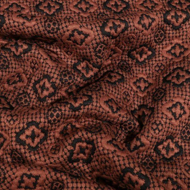 Tissu Jersey jacquard losanges et cercles noirs sur fond Marron - Par 10 cm