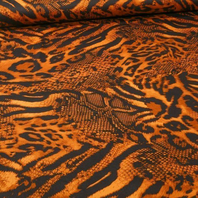 Tissu Tissu Coton Satiné extensible  reptile et félin sur fond Orange - Par 10 cm