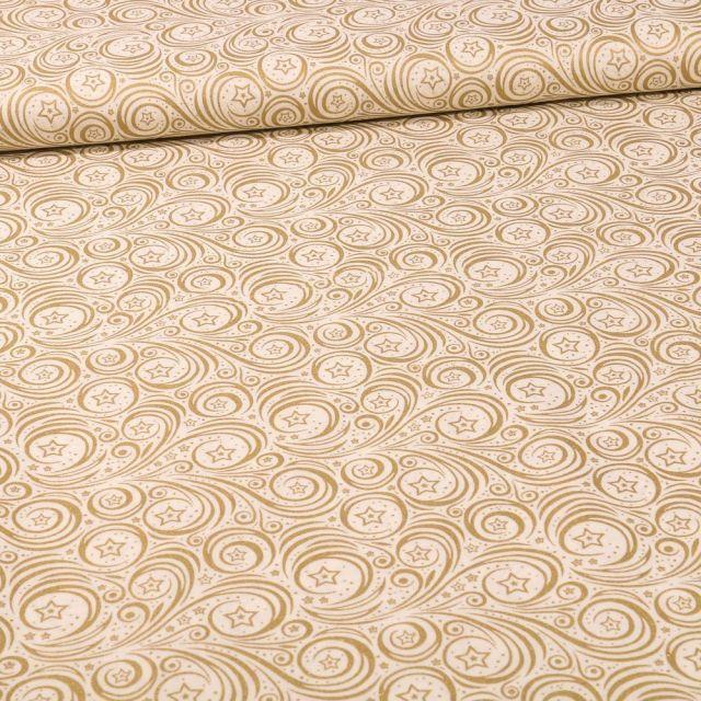 Tissu Coton imprimé Etoiles et spirales dorées sur fond Blanc cassé - Par 10 cm