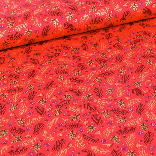 Tissu Coton imprimé Feuilles dorées de noël sur fond Rouge