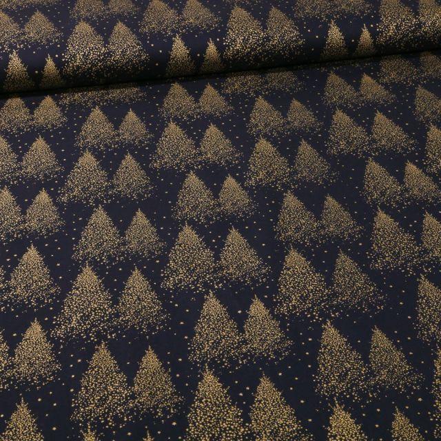 Tissu Coton imprimé Sapins dorés sur fond Bleu marine - Par 10 cm