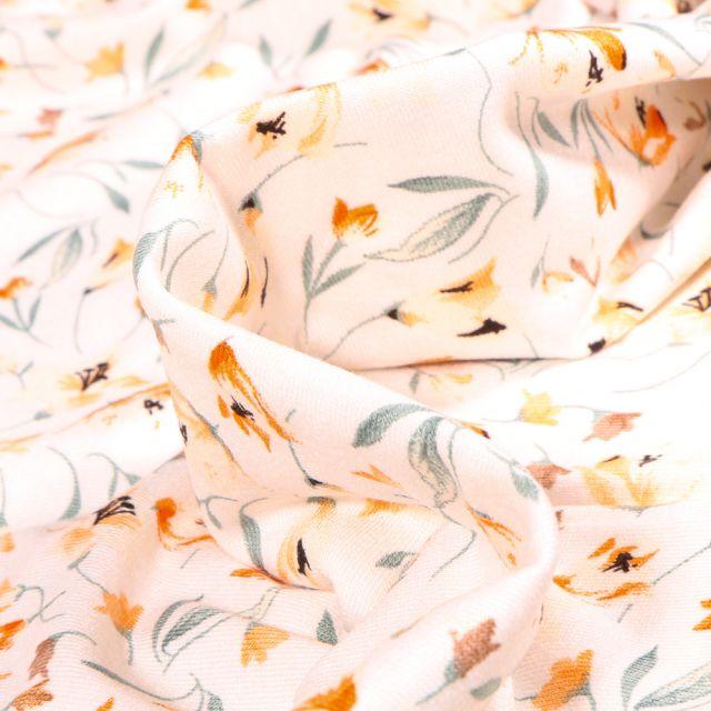 Tissu Jersey Viscose  Tess sur fond Blanc cassé