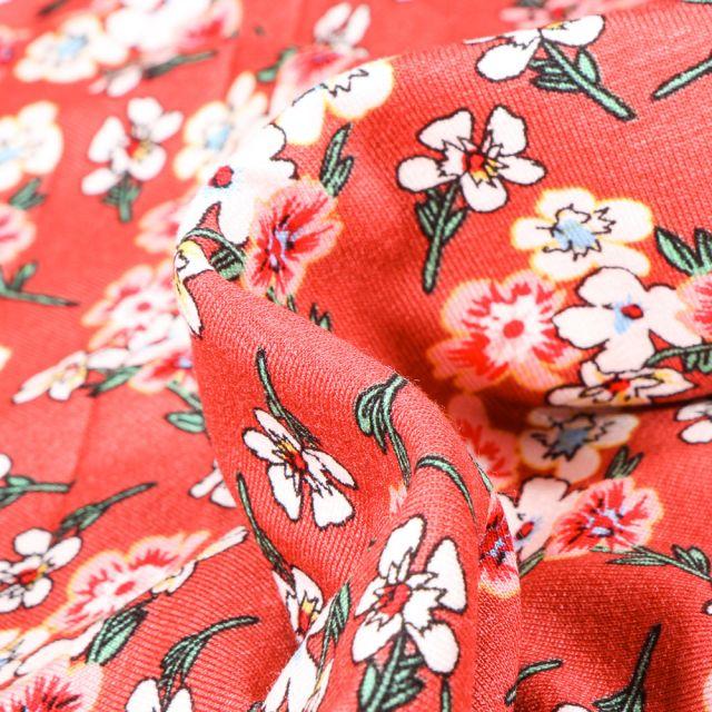 Tissu Jersey Viscose  Bouquets de fleurs colorés sur fond Corail