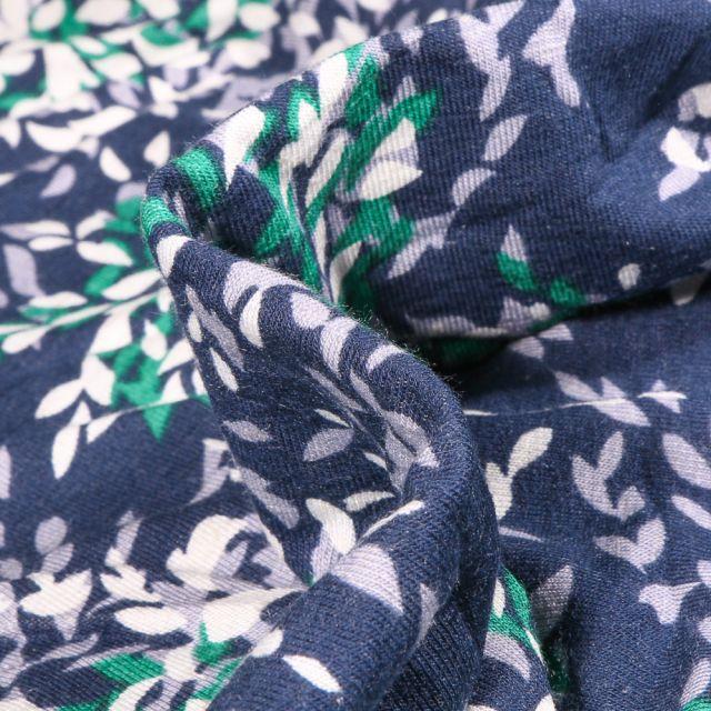 Tissu Jersey Viscose Lin Pétales de fleurs  vertes grises et blanches sur fond Bleu marine