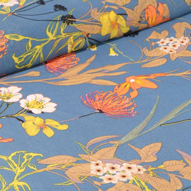 Tissu Mousseline Nupans et fleurs diverses sur fond Bleu