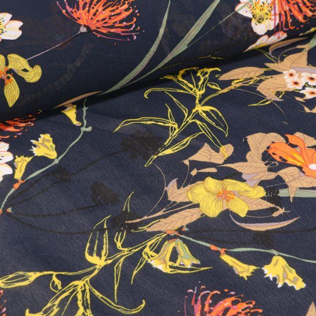 Tissu Mousseline Nupans et fleurs diverses sur fond Bleu marine