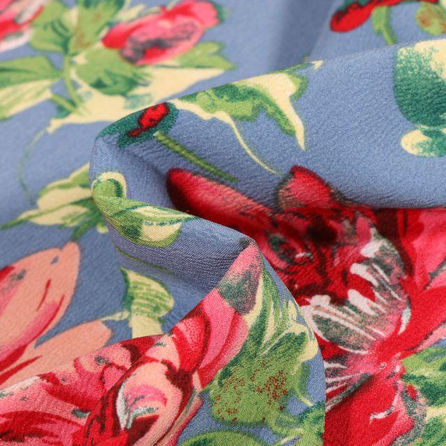 Tissu Crêpe stretch Pivoines colorées sur fond Bleu