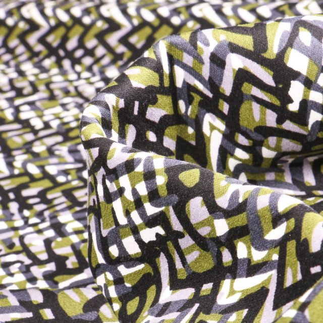 Tissu Coton satiné extensible Zig zag sur fond Vert