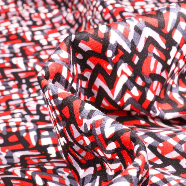 Tissu Coton satiné extensible Zig zag sur fond Rouge
