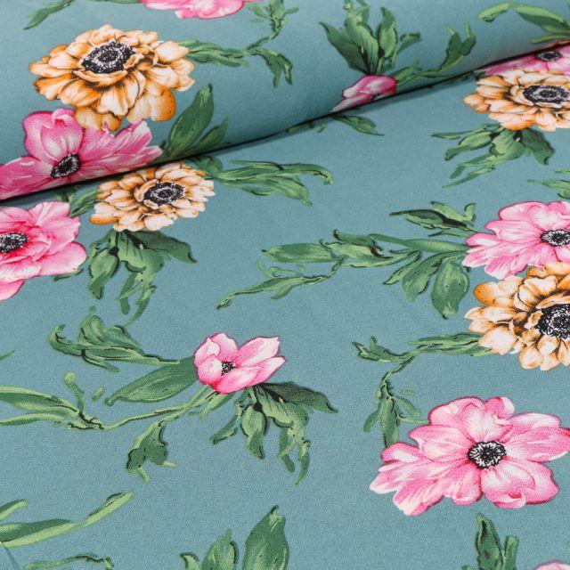Tissu Crêpe Georgette Pivoines rose et jaune sur fond Vert