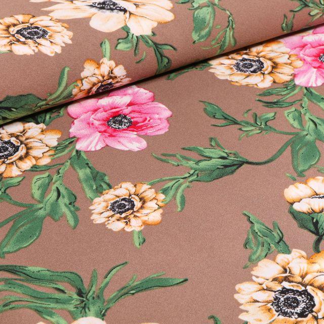 Tissu Crêpe Georgette Pivoines rose et jaune sur fond Marron