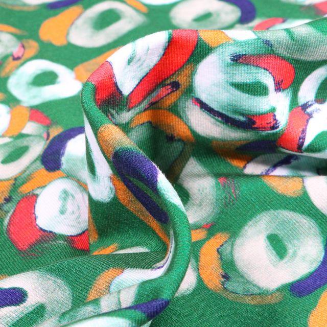 Tissu Jersey Coton Formes abstraites blanches et rouges sur fond Vert