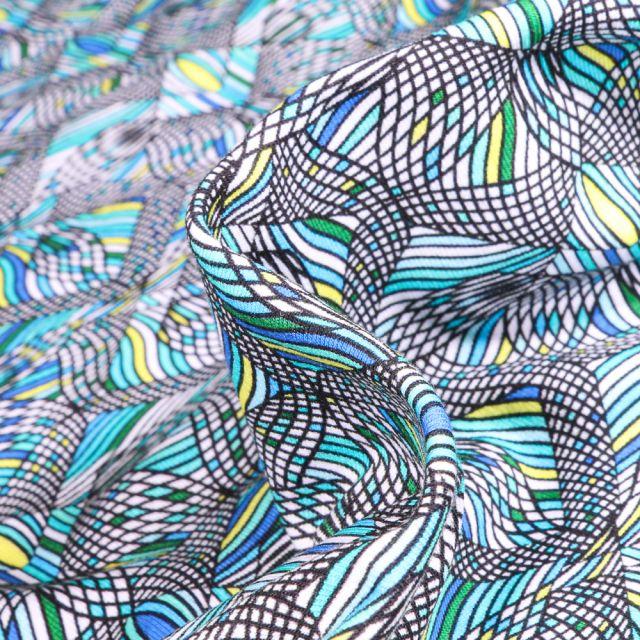 Tissu Jersey coton Formes psychédéliques sur fond Bleu turquoise