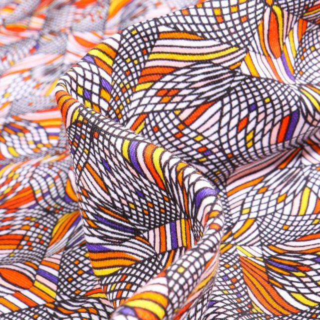 Tissu Jersey coton Formes psychédéliques sur fond Orange