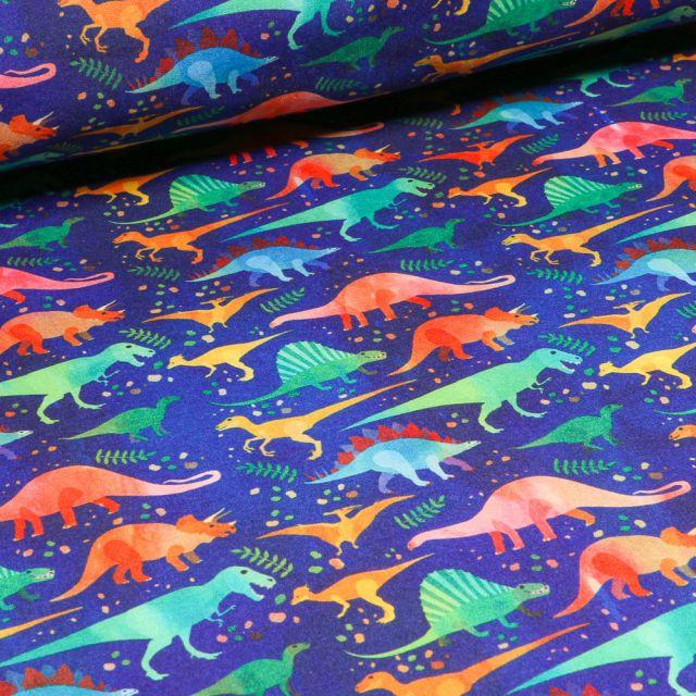 Tissu Softshell Dinosaures multicolores sur fond Bleu