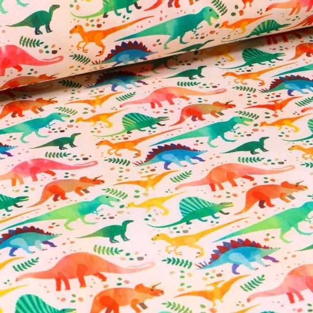 Tissu Softshell Dinosaures multicolores sur fond Ecru