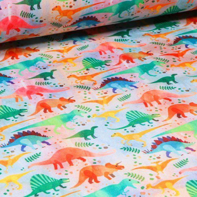 Tissu Softshell Dinosaures multicolores sur fond Blanc