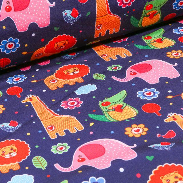 Tissu Softshell Animaux de la jungle multicolore sur fond Bleu