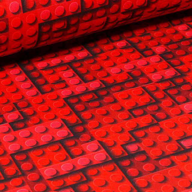 Tissu Softshell Jeux de construction sur fond Rouge