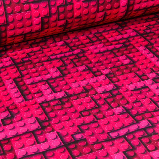 Tissu Softshell Jeux de construction sur fond Rose