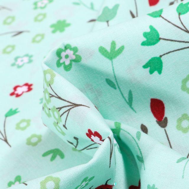 Tissu Coton imprimé Ladybug Coccinelle et fleurs sur fond Vert menthe
