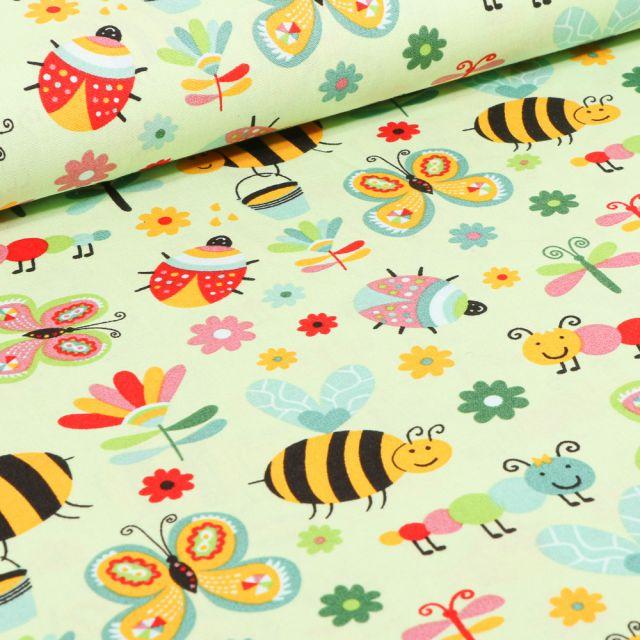 Tissu Coton imprimé LittleBird Insectes colorés sur fond Vert pâle