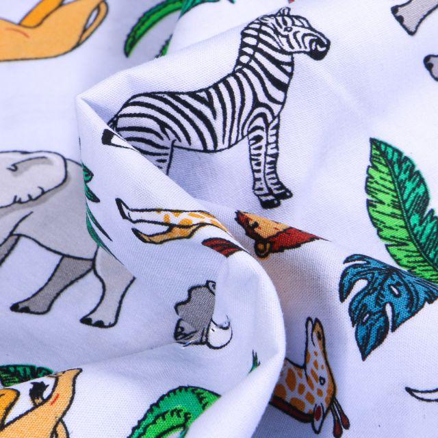Tissu Coton imprimé LittleBird Animaux de la jungle sur fond Bleu ciel