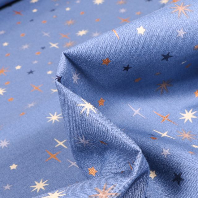 Tissu Coton imprimé Etoiles scintillantes sur fond Bleu