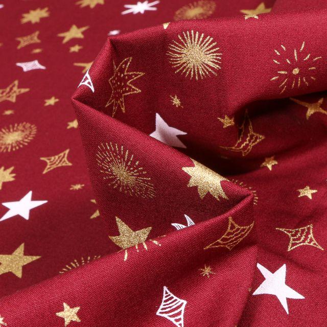 Tissu Coton imprimé Etoiles différentes formes sur fond Bordeaux