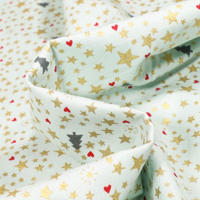 Tissu Coton imprimé Sapins et étoiles dorées sur fond Vert menthe
