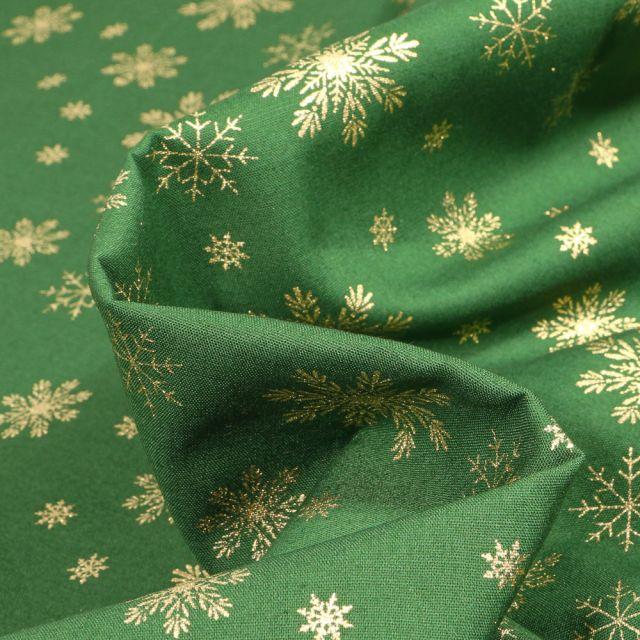 Tissu Coton imprimé Flocons de neige dorés sur fond Vert foncé