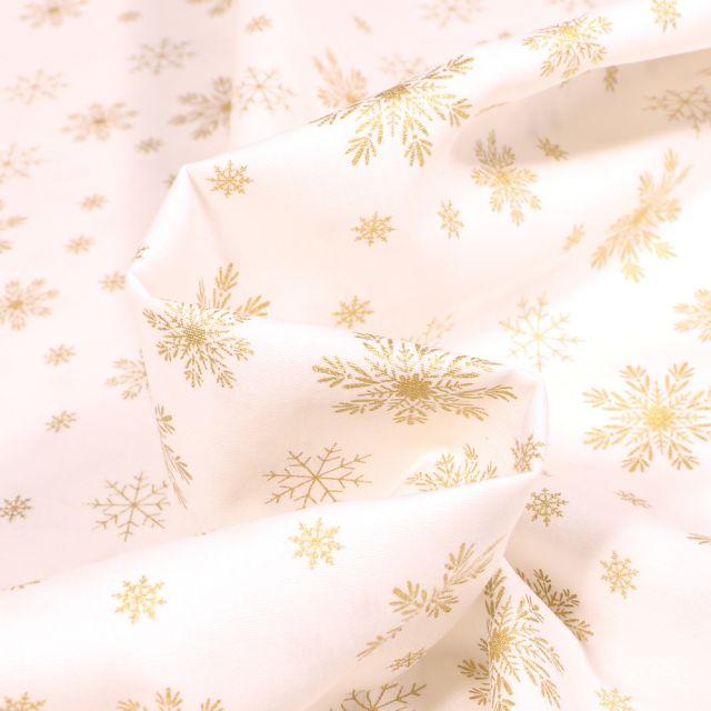 Tissu Coton imprimé Flocons de neige dorés sur fond Blanc