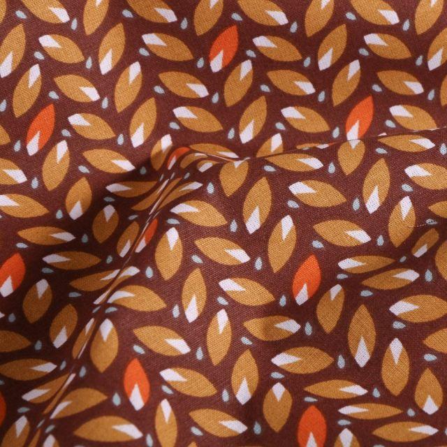 Tissu Coton imprimé Arty Feuilles ocre et orange sur fond Prune - Par 10 cm