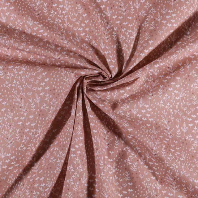 Tissu Coton imprimé Feuilles et fleurs blanches sur fond Rose - Par 10 cm