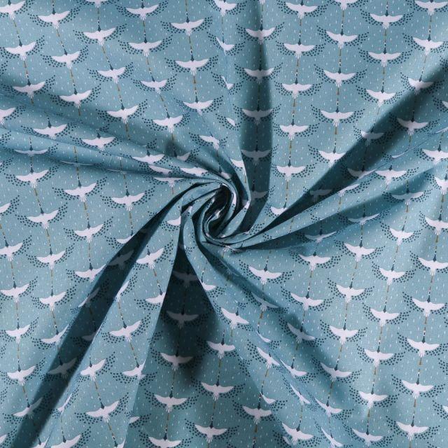 Tissu Coton imprimé Oiseaux blancs et petits pois sur fond Bleu - Par 10 cm