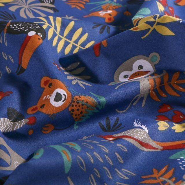 Tissu Coton imprimé Arty Animaux de la jungle sur fond Bleu - Par 10 cm