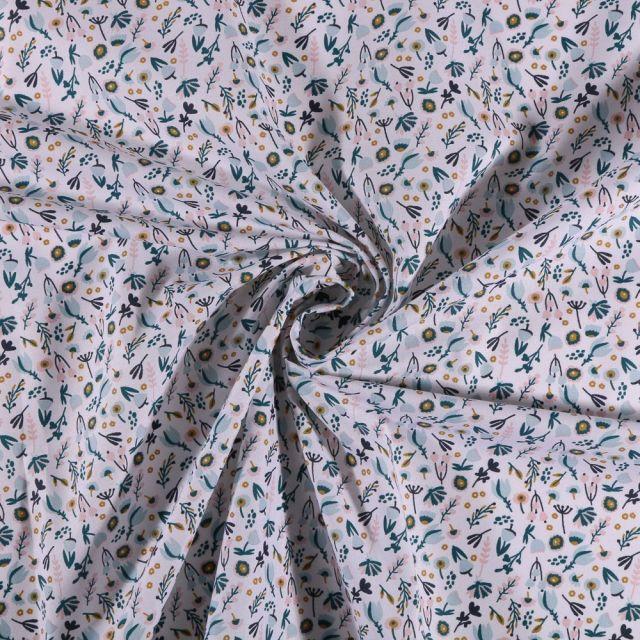 Tissu Coton imprimé Petites fleurs ocre et bleues sur fond Blanc - Par 10 cm