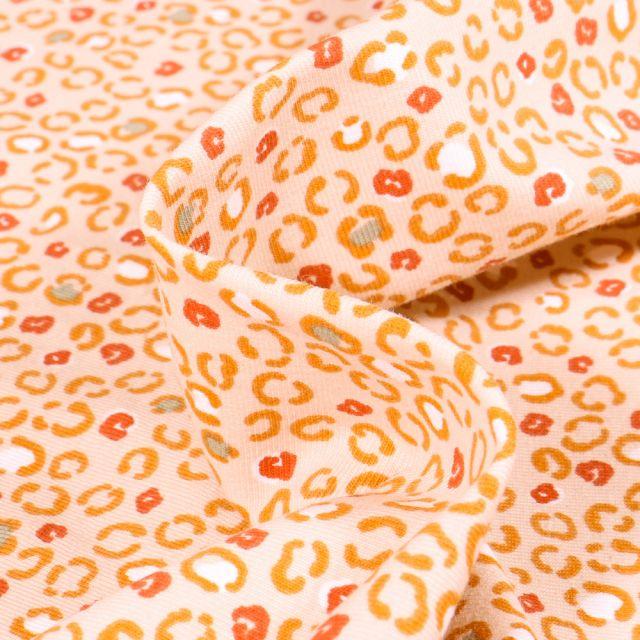 Tissu Jersey Coton Arty Cougui sur fond Saumon